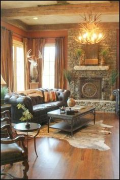 Rustic Living Room: I love how they have the mount by the windows displayed on a pillar rather than just the wall.