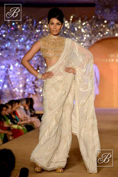 Abu Jani Sandeep Khosla white saree with designer blouse