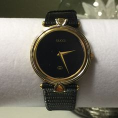Authentic Vintage Gucci Watch WORKING Swiss made Gucci watch. The crystal and battery are brand new and the movement has been checked and it's perfect by a certified watchman. The wristband is the original and has some minimal wear. Size: Medium/ Large, up to 8in,, MODEL NAME : Vintage Gucci Gold Plated Quartz Mens Midsize Watch, Movement : Swiss, quartz movement, : Gold platedCrystal :  : leather bracelet up to 7'' or 17.5cm wrist size NO BOX.         Newly calibrated and in perfect…