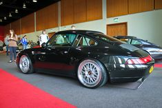 Porsche 911 (993). Dig the ride-height, roll-bar, color, and those bad-to-the-bone BBS's! (Click on photo for a great high-res. image.)