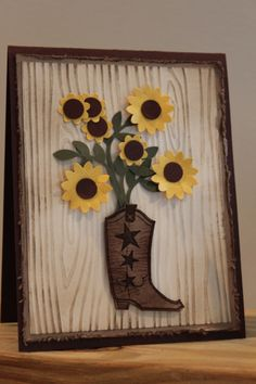 handmade card ,,, charming Western theme ... embossing folder wood grain lightly sponged ,,, die cut cowboy boot serving as a vase for a bunch of punched daisies ,,, luv it!!