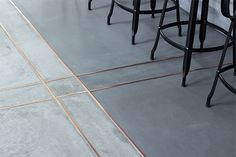 Concrete floor with inlaid copper at a Tokyo restaurant - designed by Daikei Mills. 1508 London on Concrete Luxury in Interior Design