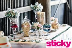 Sticky custom made lollypops on a candy buffet. Fun and beautiful.
