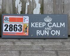 Medals Holder Display and Race Bib Rack Running Gift Combo - Keep Calm and Run On. $37.50, via Etsy.
