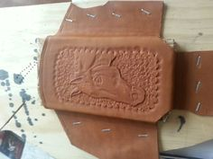 Horse head tooling for cell phone case.