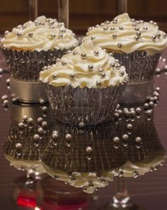 White Cupcake With Silver Decorations Royalty Free Stock Photo, Pictures, Images And Stock Photography. Image 14271458.