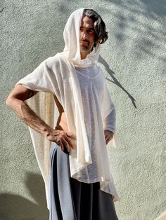 Mens White Knit Poncho, Wonderful Kundalini or Festival Outfit. Great as a cover up, warm and soft, this poncho will be a great addition to any wardrobe! The source of material was limited, and only few pieces were made from this fabric. Handmade with so much love and care... Material: offwhite (cream/ivory) upcycled knit cotton blend. Fabric was bought in Fashion District LA, and the poncho was handmade in one of our studios in California. Size: One size. Overall Length: 45 in. Overall Width: 5 Hooded Poncho, Knitted Poncho, Nomad Fashion, Fashion 2017, Men Fashion, Off White Hoodie, Mens Cape, White Poncho, Festival Poncho