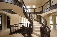 Image from http://www.prestcon.ro/mobilier-tamplarie-lemn/scari-interioare-lemn/scara-de-interior-din-lemn-masiv-de-mahon.jpg.