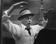 Frank Sinatra at the mike   Sinatra, moments before swatting mosquitos on each of his thighs.