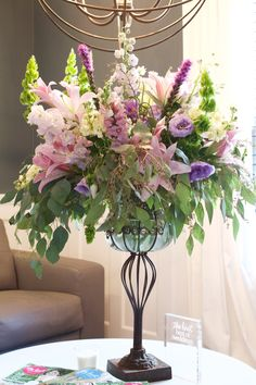 Loving the palette of purple and pink in this tall arrangement. #inbloomfloral #tallcenterpiece #ctwedding #ctevent #wedding #powerstationevents
