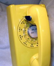 kitchen rotary wall phone, we had a party line too, you could pick up the phone and hear someone else talk. Had to hang up and wait for them to finish.