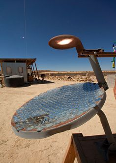 """Solar """"fryer"""" made from an old satellite dish.    More about being off the grid in West Texas: http://www.nytimes.com/interactive/2011/03/10/garden/20110310-TEXAS-SLIDESHOW.html?ref=garden&_r=1"""
