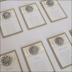 Beautiful crystal buttons, textured papers and satin ribbon dior bows make up this couture wedding table plan.