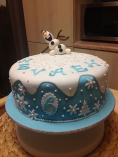 Disney's Frozen Cake  circle cake, single tier with trees, Olaf, and snowflakes