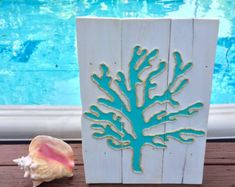 This beachy piece of art is made from reclaimed pallet wood and is perfect for a nautical inspired beach house! Each sign is hand cut, hand sanded and painted. Each sign is made to order so no two will be exactly alike due to variations in the wood. All signs have cable wire on the back for easy hanging. Dimensions are approximately 28 x 17 inches.