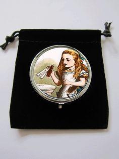Alice In Wonderland Drink Me Medical Pill box Pillbox Case Trinket Box Storage. $7.50, via Etsy.