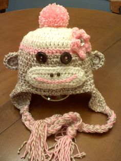 Girl Pink and Tan Sock Monkey Hat with Flower and Top Pom Pom - Size 6-12 months. $28.00, via Etsy.