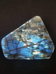 5 LARGE/GORGEOUS and Colorful Polished Free Standing Labradorite from Madagascar This Crystal has amazing blue and yellow flashes- It measures aprox. 5.25x2.5x 4.5 Weighs 3lbs 1.6oz This listing is for the stone pictured This beautiful free standing Crystal would be great in your office,