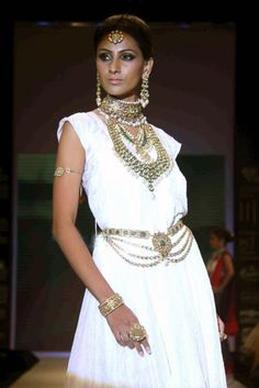 All white and dripping in jewels....