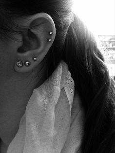 I like how she has her triple lobe piercing but the 1st and second are close and the 3rd one is a little more up