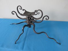 Forged octopus candleabra by Kriev of Pike Lake Forge.