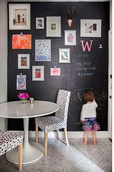 Love the chalkboard wall with the pictures. Like the clips to hold artwork too.