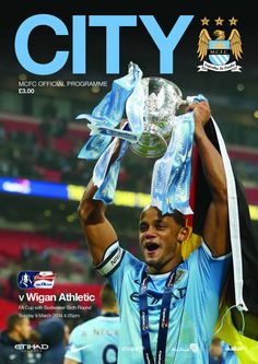 92de8b32e45 Vincent Kompany holds the Capital One Cup aloft on the programme cover for  a game against Wigan - City Quiz -