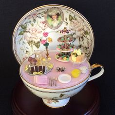 Using a teacup as a setting for a miniatures is such fun.