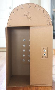 Box Elevator with Push Buttons DIY large (kid-sized) cardboard box elevator with push buttons - so cool! From Repeat Crafter MeDIY large (kid-sized) cardboard box elevator with push buttons - so cool! From Repeat Crafter Me Cardboard Box Crafts, Cardboard Toys, Cardboard Furniture, Cardboard Playhouse, Cardboard Box Ideas For Kids, Cardboard Kitchen, Cardboard Castle, Cardboard Box Houses, Wooden Toys