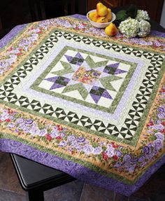 """This free quilt pattern is called, """"Spring Radiance"""". It was inspired by the sunny landscape in France, the stunning floral border fabric acts as a catalyst for the remaining fabric and color choices. Mitered borders enclose the pieced center square."""
