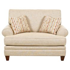 A stylish addition to your living room or den, this classic accent chair features tan upholstery and complementing accent pillows.  ...