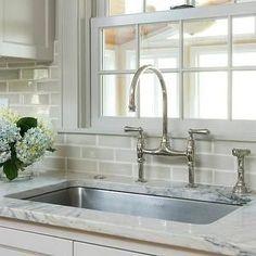 Bright White cabinets with pewter glaze | crackle glaze gray tiled backsplash