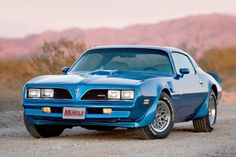 """1978 Firebird Trans Am w/WS6 package (mostly a few meatier suspension bits, the all-important 4-wheel disc brakes, and 15x8 """"snowflake"""" rims) in Martinique Blue, which was THE color to have in my opinion (full disclosure: my much-beloved '78 Formula was that color, CA-spec 350 Chevy motor notwithstanding)."""