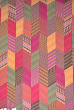 GORGEOUS USE OF STRIPED SHAPES - Kaffe Fassett Arrow Feathers Quilt for Sarah (sister)