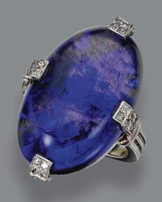 Black opal and diamond ring, circa 1920. The oval black opal measuring approximately 23.3 by 15.1 by 8.9 mm., the prongs set with 32 single-cut diamonds, mounted in platinum.