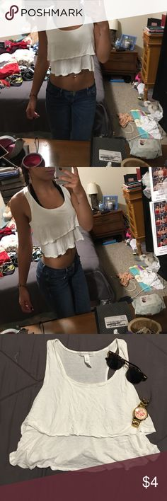 Casual tank top White very loose fitting cropped tank top. Three ruffles on front. Never worn, like new condition. Pairs great with nice jeans and heels for a night out in the city. Ambiance Apparel Tops Crop Tops