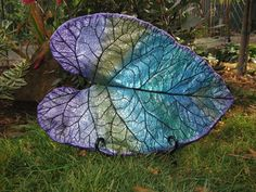 Peacock Paint Colors | Peacock colors painted on a concrete casting from a real burdock leaf ...