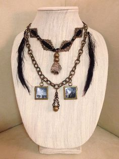 This necklace has an urban, fun, rock n roll edge with some steampunk flavor. It features prints of original oil portraits of rock legends: the