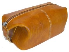 "Floto Olive Brown Leather Travel Dob (or Dopp) Kit by Floto. $119.00. Italian Polished Calf-Skin Leather. 4"" high x 5 "" wide x 10"" long. 100% Cotton/Denim Lining. Inside Zip Pocket. The Venezia Travel Kit comes in five colors - Tuscan Red, Orange, Vecchio Brown, Olive Brown, and Black. The interior of this handbag is lined with rugged 100% Cotton/Denim and includes an inside zip pocket."