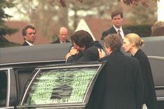 3 Jan 1998. Funeral of Michael LeMoyne Kennedy at Our Lady of Victory Church in Centerville. John Kennedy Jr. embraces his cousin Douglas, Michael's brother.