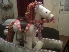 Get ready for some serious cuteness! Angie sent in an ADORABLE picture of a diaper rocking horse she made for a her first grandbaby. She did a fabulous