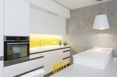 White kitchen with some yellow