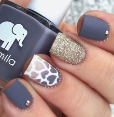 Matte blue gray nail polish with white and gold glitter. The matte design is accompanied by a gradient design as well in hear details. It looks very charming and classy at the same time.