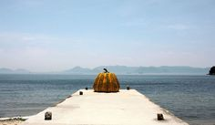 """The Benesse House Museum on Naoshima island, where museums, installations and cutting-edge architecture blend with nature in novel ways. A """"pumpkin"""" by Yayoi Kusama looks over the Seto Inland Sea."""