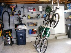 Are you tired of tripping over and weaving round bikes each time walk into your garage? Garage bike hanger can answer this problem easily and efficiently Bicycle Storage Garage, Bike Storage Design, Bicycle Garage, Bike Storage Rack, Overhead Garage Storage, Diy Storage, Storage Ideas, Smart Storage, Tool Storage