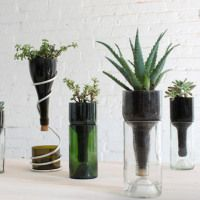 I love the look of this simple glass planter made from an empty wine bottle. The best part is that it's incredibly simple to make. All you need to do is remove the label and cut the bottle in half. For instructions on how to do that, visit HomeMade Modern (they even have a video showing you how to do […]