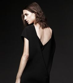 December Nights: The sleek seasonal silhouette of our Charriere Dress lends a darkly glamorous edge.
