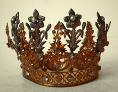 """From some photos, I can't be sure which crowns are """"real"""" and which ones are made by crafters and kids, or for a wedding.  I like folk art-ish ones the best!"""