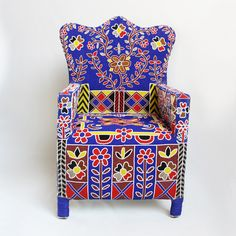 West African hand beaded tribal arm chair from Yoruba Nigeria. Thousands of tiny beads cover these artistic beautiful and functional art pieces. Each take over 3 months to make. These bold chairs were traditionally used by kings and queens from the Yoruba tribe.