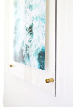How to make an acrylic frame! via A Beautiful Mess Rust oleum Gold spray paint the hardware, buy acrylic kit from amazon.